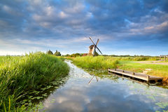 Dutch windmill and blue morning sky Stock Photo