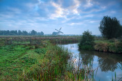Dutch windmill and blue morning sky Stock Photos