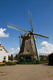 Dutch windmill with blue sky Stock Photography