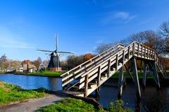 Dutch windmill and bridge Royalty Free Stock Photos