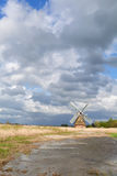 Dutch windmill bu river over beautiful sky Stock Photography