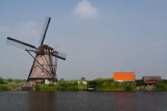 Dutch windmill on a canal Royalty Free Stock Image