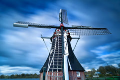Dutch windmill and clouded sky Stock Image