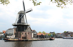 Dutch windmill De Adriaan along Spaarne in Haarlem royalty free stock image