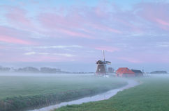 Dutch windmill in dense morning fog Stock Photography