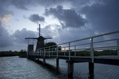 Dutch windmill. A dusk shot of a traditional Dutch windmill at Kinderdijk, Netherlands Stock Image