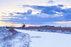 Dutch windmill in winter at sunrise Royalty Free Stock Images