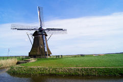 Dutch Windmill in the Grassland Stock Image