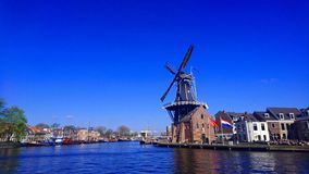 Dutch windmill in Holland stock photography