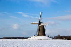Dutch Windmill Holland in Winter. Windmill in Holland on a snowy Winter day stock photo
