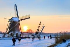 Dutch windmill ice skating Royalty Free Stock Photos