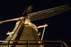Dutch windmill illuminated in the dark Stock Photo