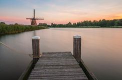 Dutch windmill and a jetty Royalty Free Stock Photo