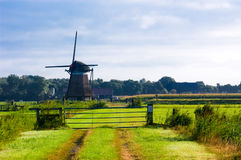 Dutch windmill landscape Royalty Free Stock Photo