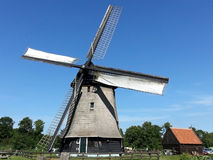 Dutch windmill. And little house in Nederland Royalty Free Stock Photography