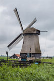 Dutch windmill in a marsh landscape setting Royalty Free Stock Images
