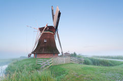 Dutch windmill in misty morning Stock Image