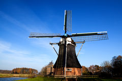 Dutch windmill over blue sky Stock Images