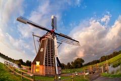 Dutch windmill over blue sky Royalty Free Stock Photos