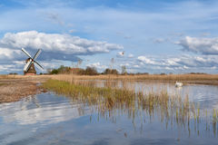 Dutch windmill over blue sky Royalty Free Stock Photography