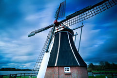 Dutch windmill over blurred sky Stock Photography