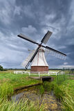 Dutch windmill over clouded sky Stock Photo