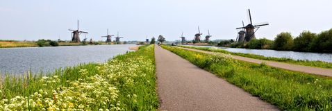 Dutch windmill panorama. Panoramic view of the windmills and canals of Kinderdijk, Netherlands Stock Photography