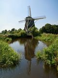 Dutch windmill on a polder Stock Photography