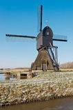 Dutch windmill in a polder landscape Royalty Free Stock Images