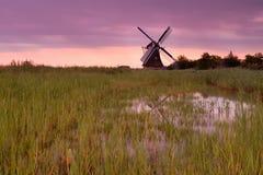 Dutch windmill at purple sunrise Stock Image