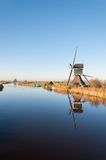 Dutch windmill reflected in a river Royalty Free Stock Photos