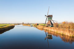 Dutch windmill reflected in a river Stock Photography