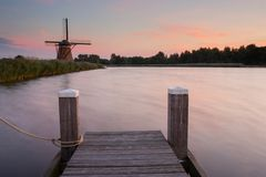 Dutch windmill reflected in river Royalty Free Stock Image