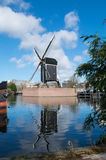 Dutch windmill reflecting in the river Rijn Royalty Free Stock Photos