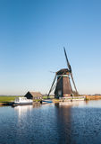 Dutch windmill on the river banks Royalty Free Stock Photography