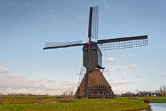 Dutch windmill with scoopwheel pump Stock Photography