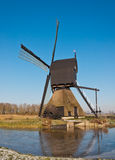 Dutch windmill with scoopwheel pump Stock Images