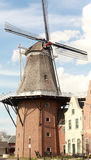 Dutch windmill. A Dutch windmill serves as the information booth for tourists visiting Pella, Iowa, during the annual tulip festival Stock Images