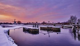 Dutch windmill in the snow of a holland winter.  royalty free stock photo