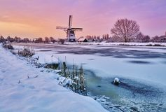 Dutch windmill in the snow of a holland winter Royalty Free Stock Photos