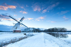 Dutch windmill in snow winter Royalty Free Stock Photo