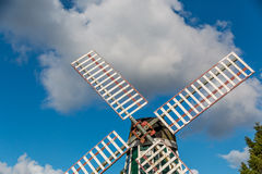 Dutch windmill. A Dutch windmill stands out against a cloudy sky Stock Images
