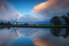 Dutch windmill at stormy sunset. Holland Stock Image