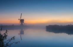 Dutch windmill at sunrise Royalty Free Stock Photos