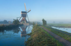 Dutch windmill at sunrise Royalty Free Stock Images