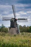 A dutch windmill in use to pump water with royalty free stock photos