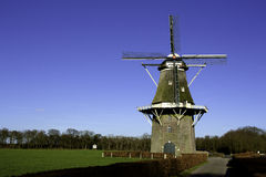 Dutch Windmill. In Vilsteren, the Netherlands, with a autumn hedge in front Royalty Free Stock Photo