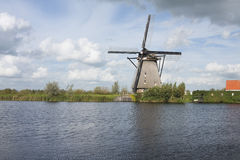 Dutch windmill at water. A traditional Dutch windmill at Kinderdijk, Netherlands Stock Image