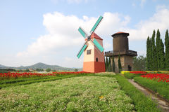 Dutch windmill and water tank Stock Photos