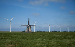 Dutch windmill and wind turbines Royalty Free Stock Images